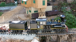 #trains #garden #shay 3-truck Shay No. 10 pulls a log train onto a curved trestle on the Fern Creek & Western G scale garden railroad in Santa Cruz, California on September 25, 2015. Daniel Cortopassi photo. © 2015 TSG Multimedia