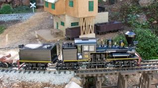 #trains #garden #shay 3-truck Shay No. 10 pulls a log train onto a curved trestle on the Fern Creek & Western G scale garden railroad in Santa Cruz, California on September 25, 2015. Daniel Cortopassi photo. © 2015 TSG Multimedia