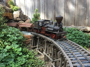 Shay #3 drifts downgrade with a loaded log train as it crosses the Priya Canyon Trestle.